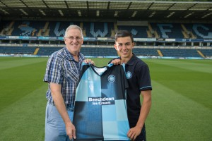 Luke OíNien of Wycombe Wanderers is presented his home shirt from his sponsor during Wycombe Wanderers Team Photoshoot 2015 at Adams Park, High Wycombe, England on 3 August 2015. Photo by PRiME Media Images.